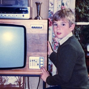 Jim aged 8 or 9 watching a shuttle launch on TV